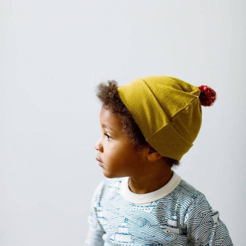Bracken Green Hat with Pompom-Hats-Hazel Village-online baby shop- online boutique for kids-sawyer + crew-Baby Clothing-Kids Clothes-Toddler Clothes- cute newborn clothing-clothing for babies- mommy and me-twinning tees-graphic tees for moms and kids-online boutique for babies-boho clothes for kids-online store for kids-organic clothing for babies