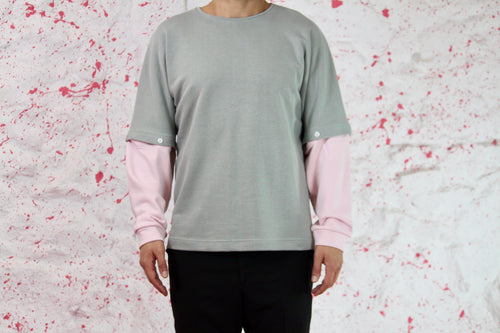 Green sweatshirt with pink removable sleeves