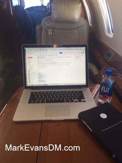 mark-evans-dm-private-jet-laptop