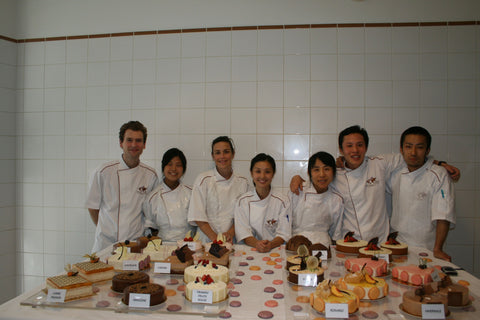 My classmates and I in front of the entremets we made