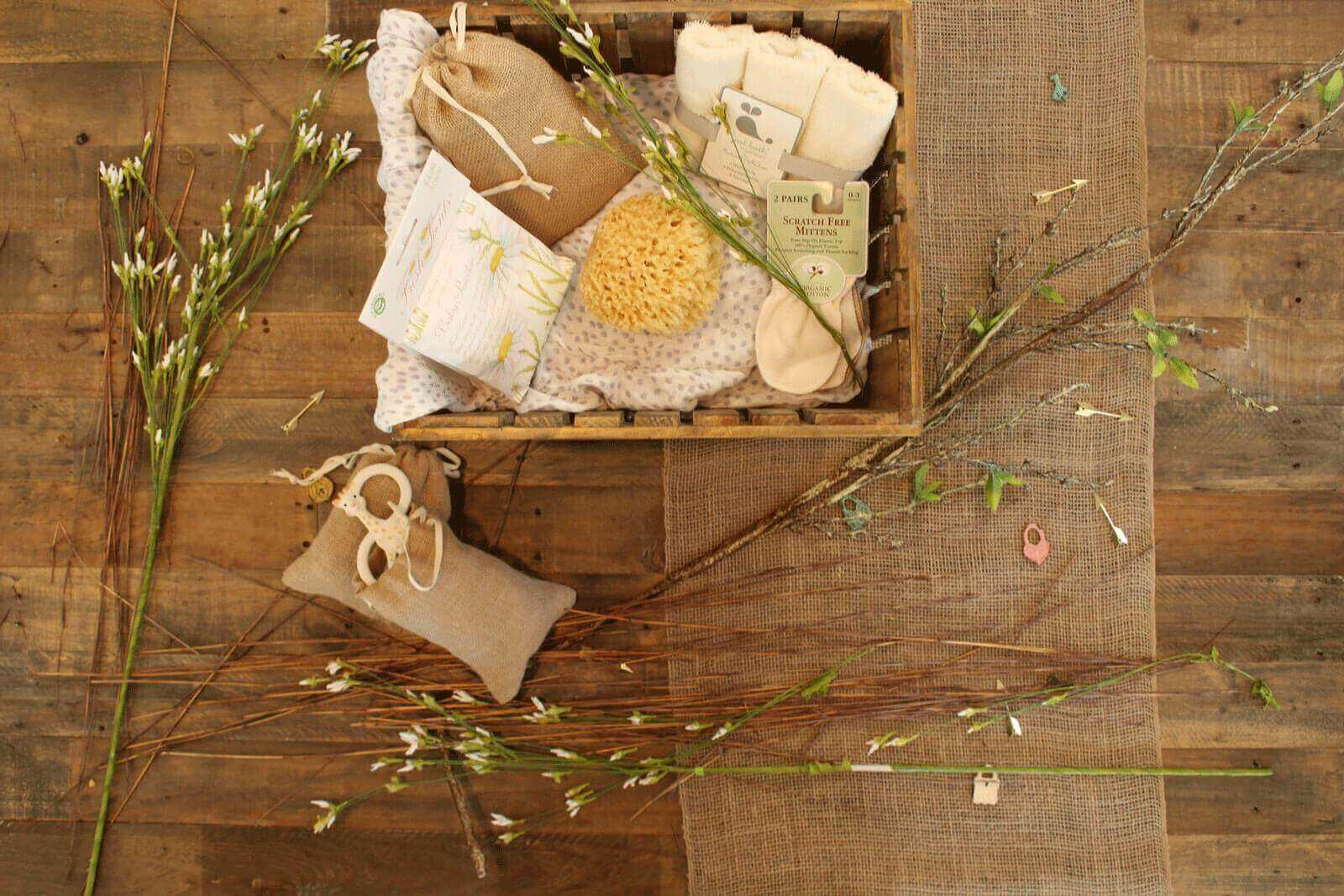 rustic wooden table with plants and a gift box of natural bath presents