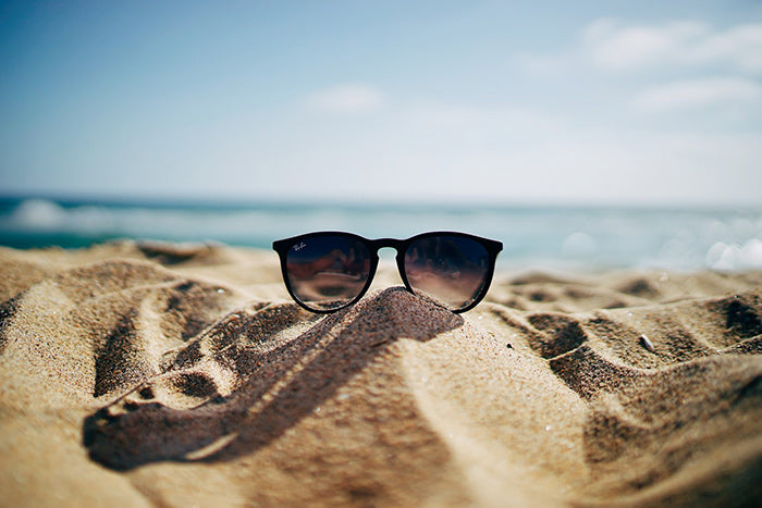 Sunglasses on a beach during summer