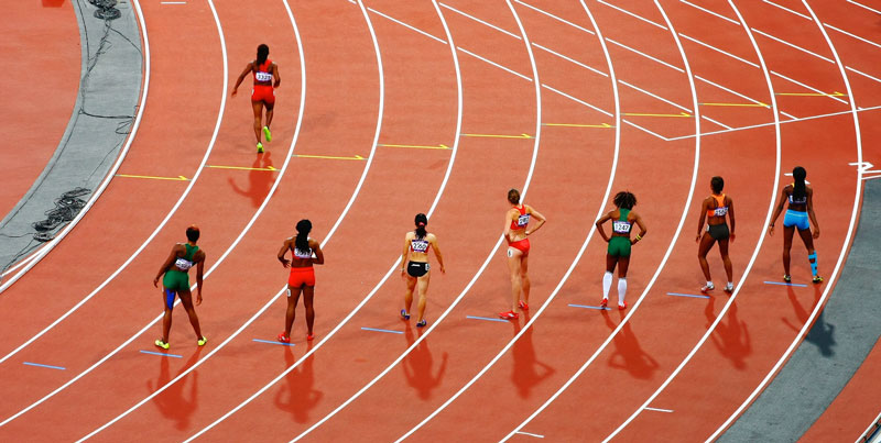 Olympic runners pose on track as an example of the WADA's stance on CBD.