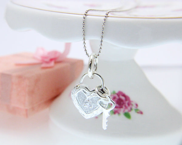 925 Sterling Silver Hawaiian Scroll Engraved CZ Heart Key Pendant Charm