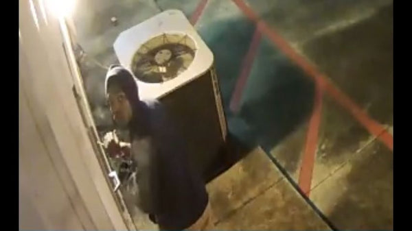 Security camera spots person trying to break into local gun store