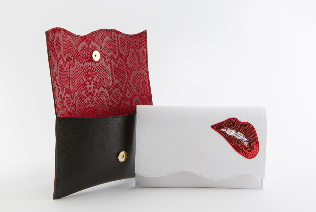 Biting Lips  on White Leather Clutch