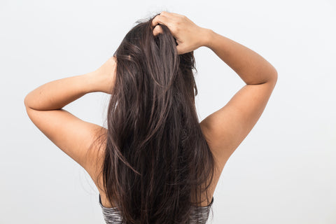 detox scalp and hair from too much product product buildup woman with hands in hair to show hair and scalp product buildup save me from product overload detoxifies hair from too much product
