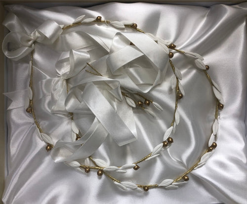 White and gold stefana for Orthodox wedding, made in Greece. White porcelain clay leaves with gold olives. Beautiful white satin ribbon attaches crowns together.