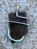Ammolite Shell Slice in Sterling Silver Tension Wrapped Pendant