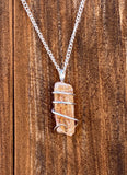 Imperial Topaz Crystal in Sterling Silver Tension Wrapped Pendant