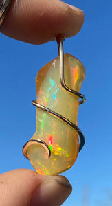 Ethiopian Opal in 14kt Gold Tension Wrapped Pendant