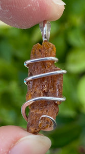 Red Kyanite Crystal in Sterling Silver Tension Wrapped Pendant
