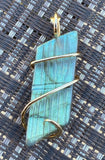 Carved Labradorite Cabochon in 14kt Gold Tension Wrapped Pendant