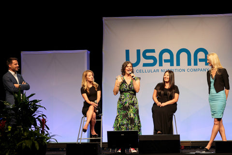 woman on stage at usana