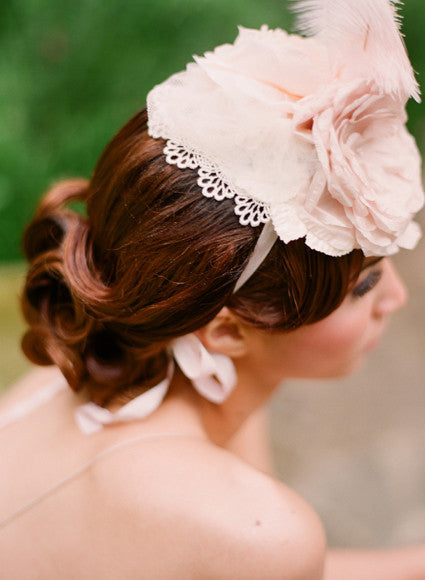 Blushing silk flower and feather bridal mini hat