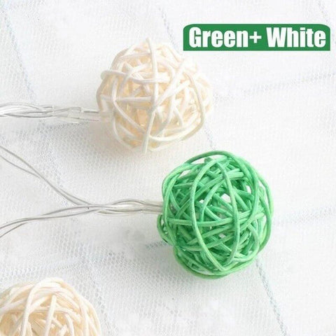 Green and white rattan ball string lights
