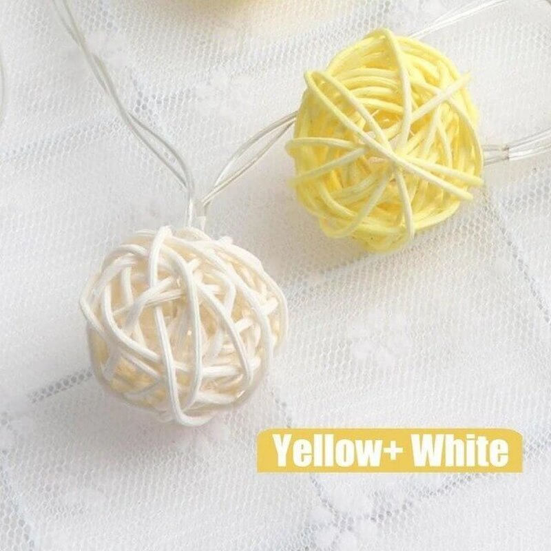 yellow and white rattan ball string lights