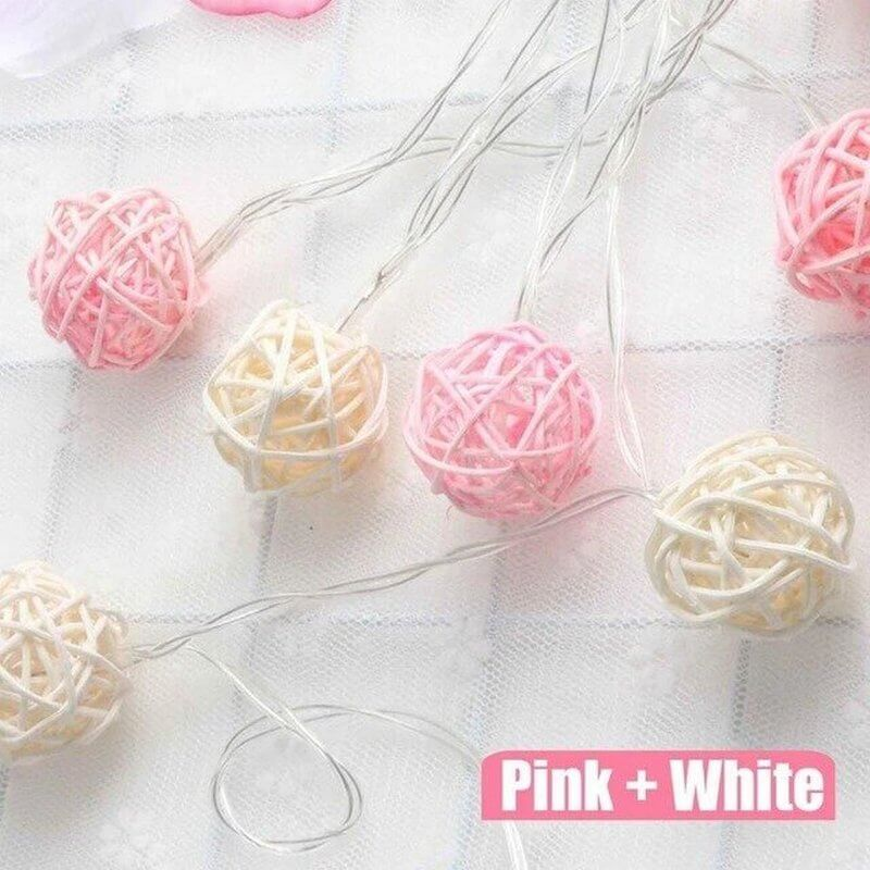 pink and white rattan ball string lights