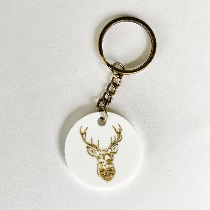 Gold stag on white