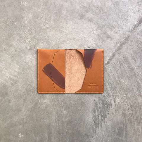 Double Slim card and cash wallet in tan painted vegetable tanned leather. Made in our studio in Tallinn, Estonia.