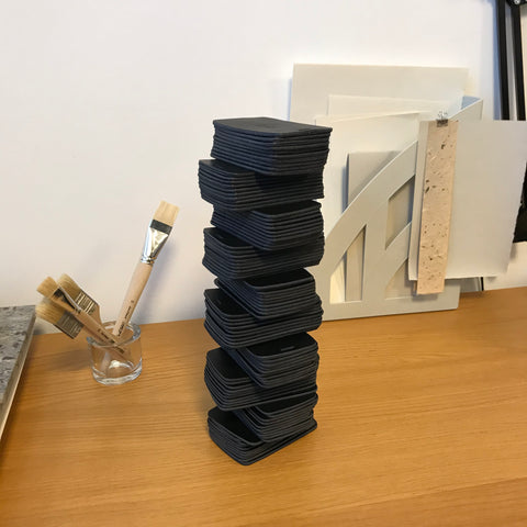 A tower of leather car remote key cases, work in progress.