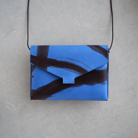 Mokoko Fold Handbag in Blue Painted vegetable tanned leather.
