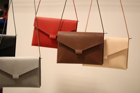 Our most popular Fold Handbag in gray, red, brown and natural leather.
