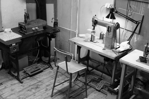 Skiving machine and sewing machine in our first shared studio.