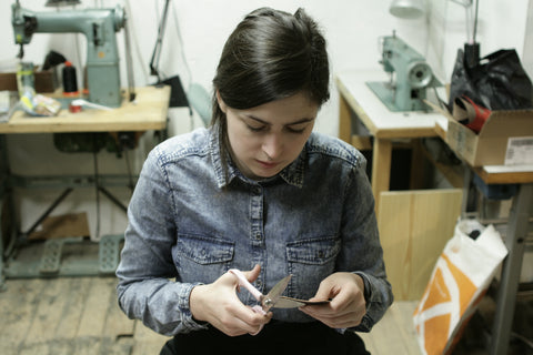 Mari working on Slim card cases at the studio.