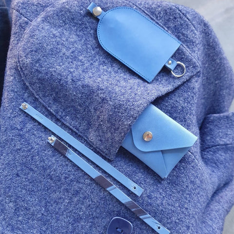Blue vegetable tanned leather key case, envelope card case and bracelets. Photo by Anna Romanova.