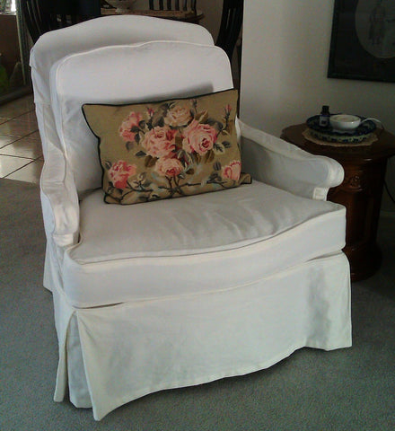 A nice mid-century French style chair and ottoman, in clean fresh white