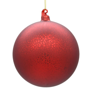 Large red Christmas tree ornament on white background