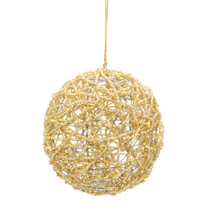 Gold beaded bauble on a white background