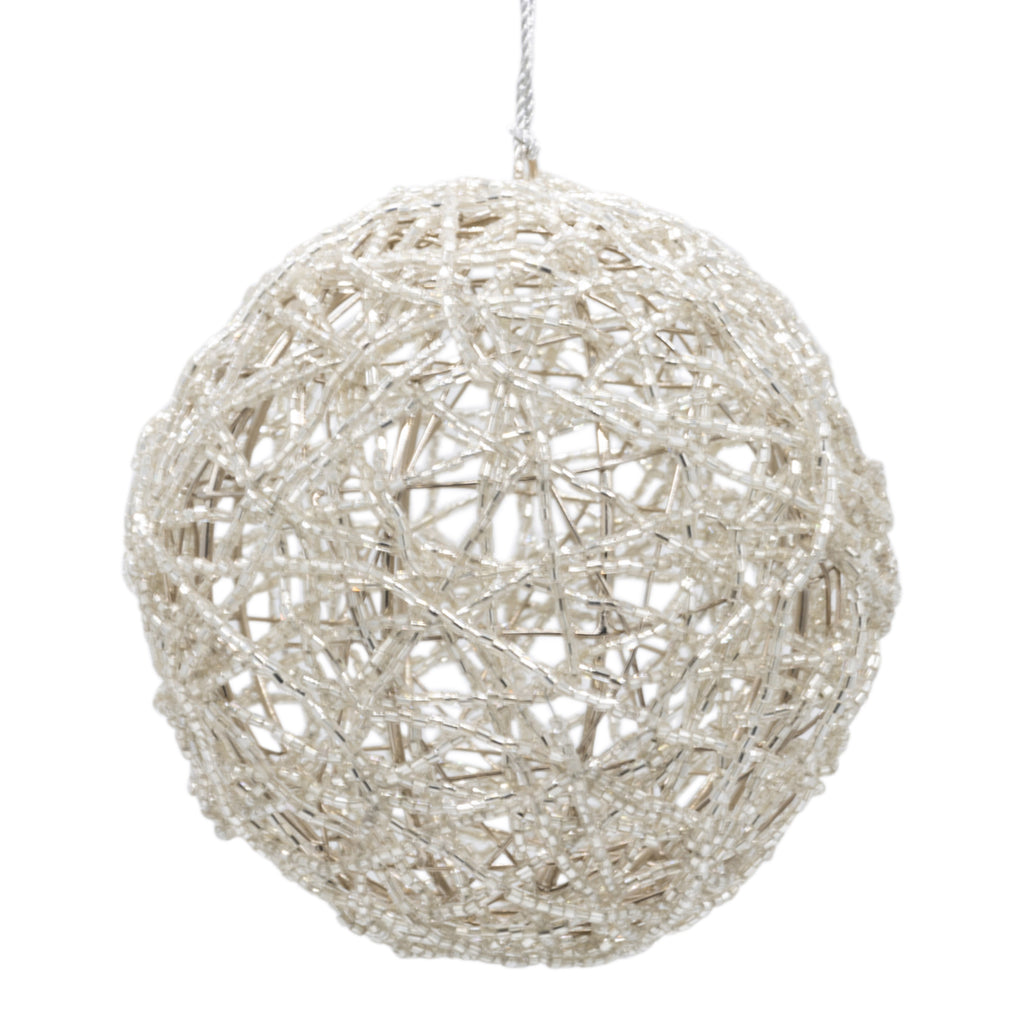 Silver beaded Christmas bauble on a white background