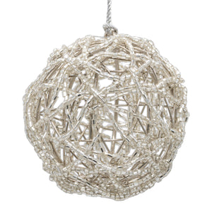 Silver beaded bauble on a white background