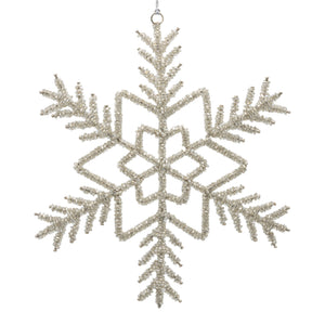 Silver beaded snowflake on a white background