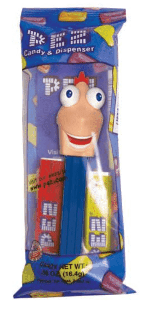 A Phineas PEZ Dispenser inside a packet with two PEZ candy refill packs.
