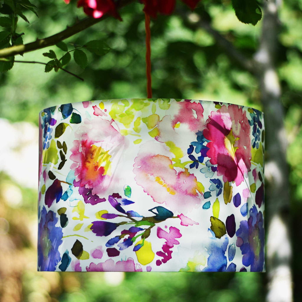 Lamp Shade in Bright Flowers Basking in the Shade of some Silver Birches