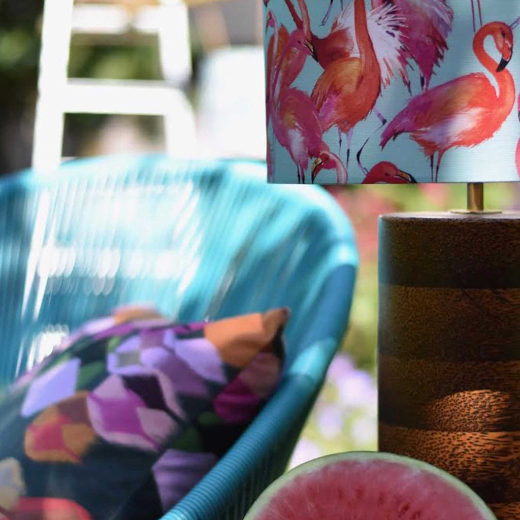 An Outdoor View of the Flamingo Lamp Shade Set Against a Garden Backdrop