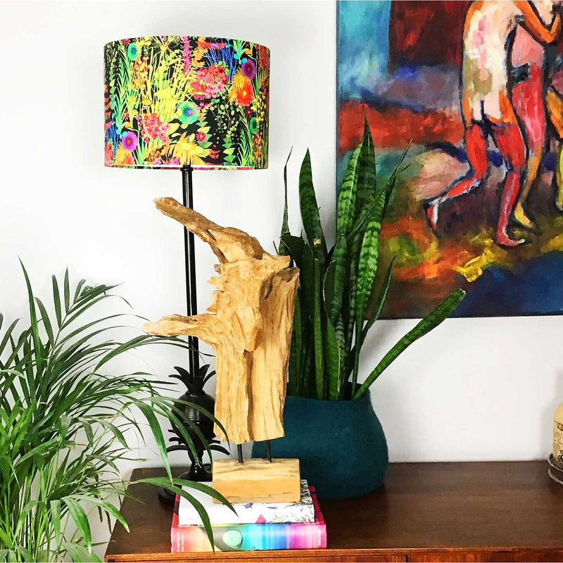 Drum Lamp Shade in Bright Wild Flowers on a Dark Background on a Liberty Fabric. This Lamp Shade is Displayed on a Thin Tall Lamp Base on a Sideboard - ZziniHome