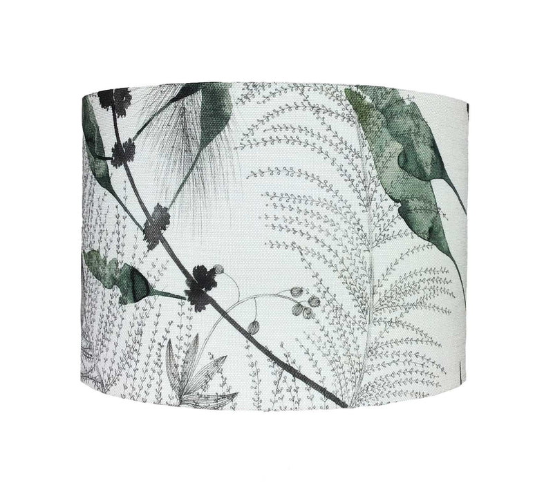 Drum Lamp Shade in a Cactus Design Against a Linen Background