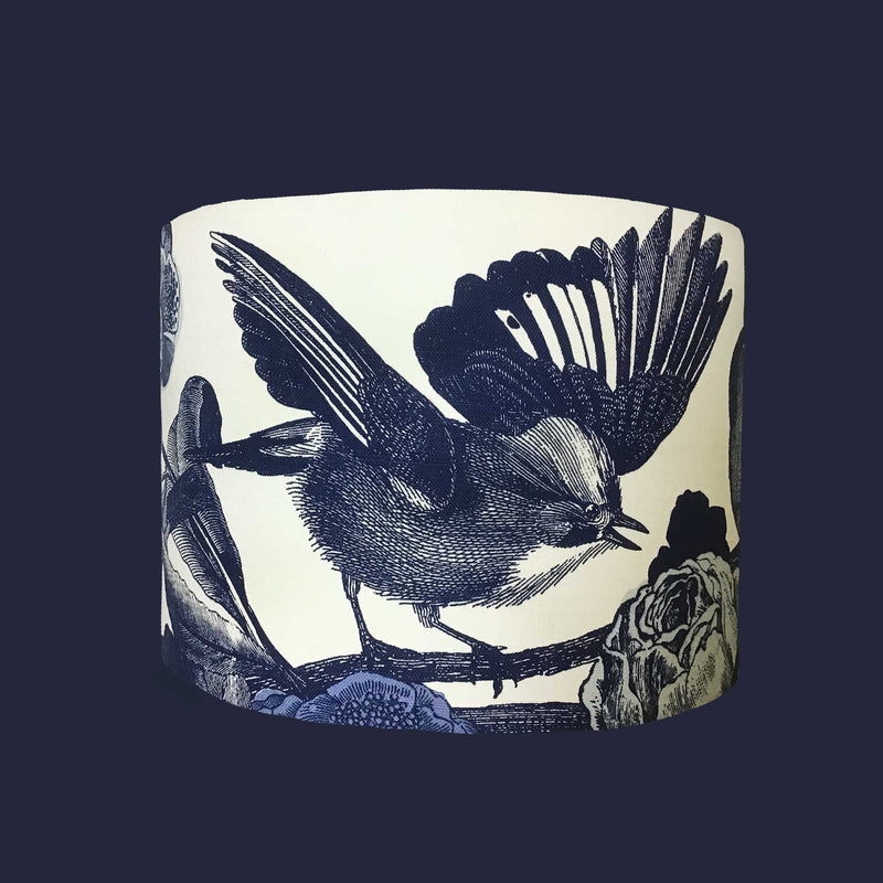 Drum Lamp Shade in a Design of the Small Birds we So Love, Drawn in a Dark Navy Colour Against a White Cotton Background, Front View. Seen Against a Navy Wall - ZziniHome