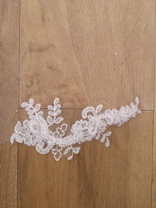 Corded lace appliqué train veil with crystal scatter