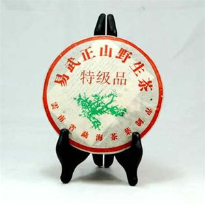 Pu-Erh Tea Cake, Yi Wu Mountain, Wild Leaves, Menghai Product Company, Year 2005 (Green/Sheng)
