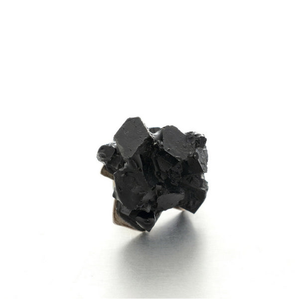 Handmade minimalist unisex jewelry design Vienna. Small black resin brooch.