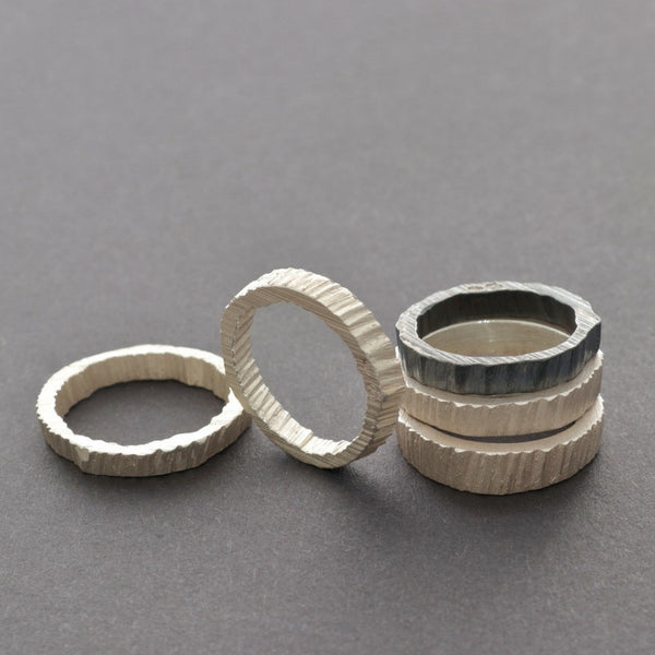 Stackable unique unisex silver rings with texture inside. Handmade in Vienna