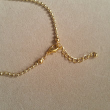 Load image into Gallery viewer, Gold tone ball chain and charm necklace