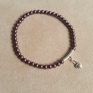 Burgundy Swarovski crystal, sterling silver tube and heart charm bracelet