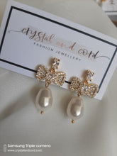 Load image into Gallery viewer, Swarovski crystal pearl drop and cubic zirconia bow gold-tone stud earrings