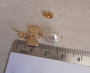 Swarovski crystal pearl drop and cubic zirconia bow gold-tone stud earrings